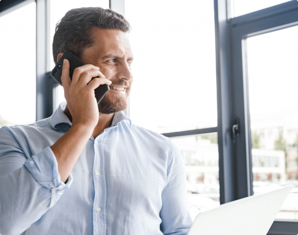happy-businessman-talking-on-mobile-phone-642TFMG